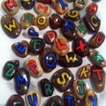 Small rocks with each letter of the English alphabet written on them