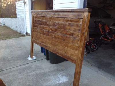 A brown, wooden headboard