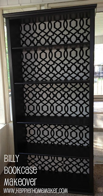 A close up of an IKEA Billy Bookcase makeover painting it black with a white and black print background