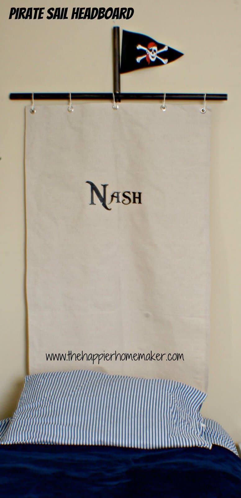 """A pirate sail headboard with the name """"Nash"""" on it"""