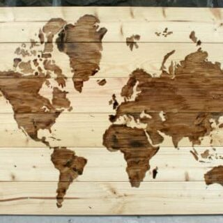 A close up of a DIY wooden world map art