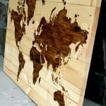 wood world map leaning against wall