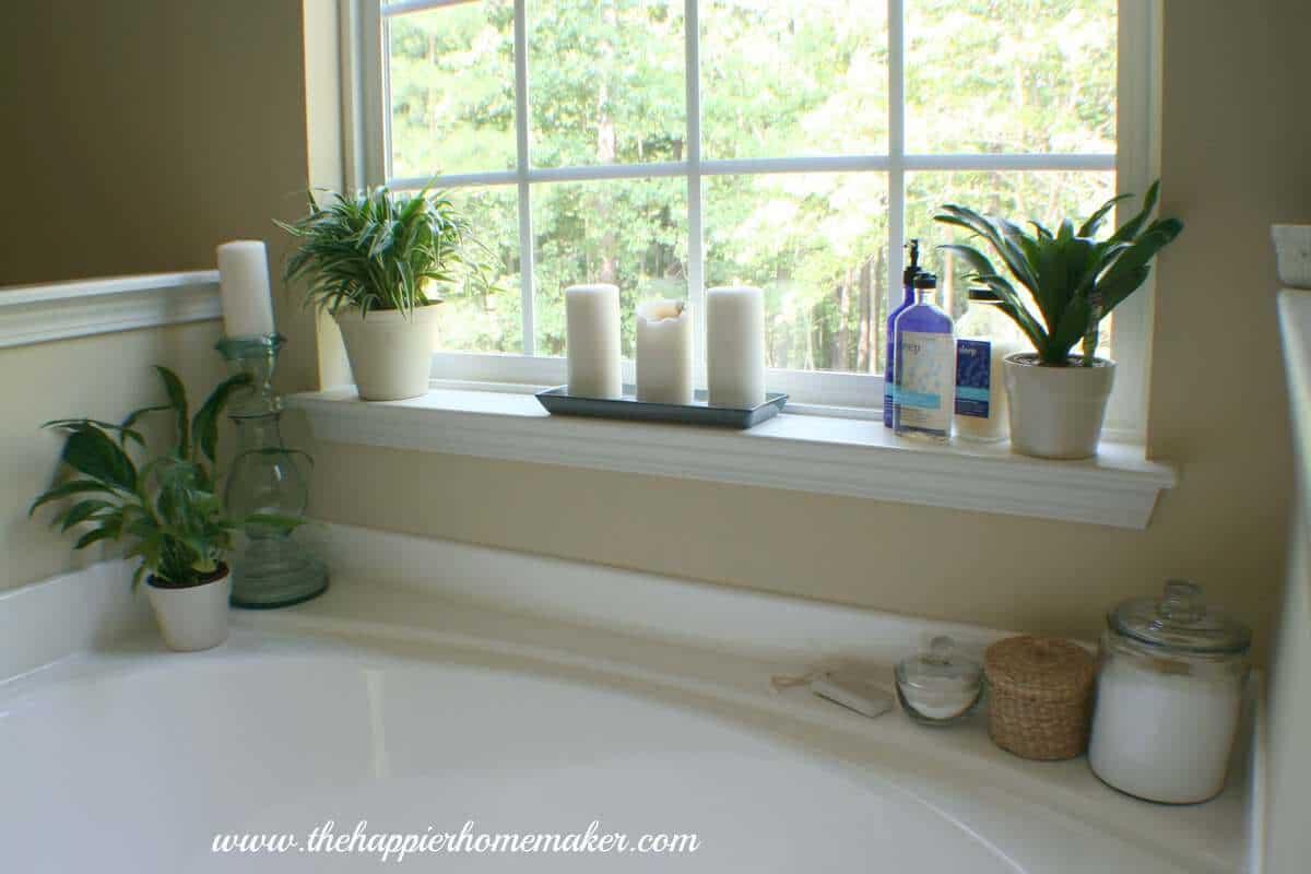 A close up of decor around a bathtub
