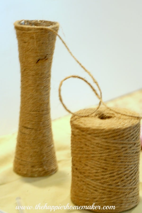 An in progress picture of how to wrap jute around a glass vase
