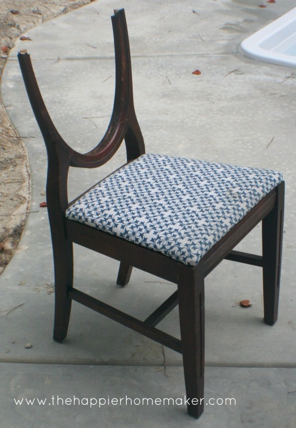 A wooden chair that is about to become a side table