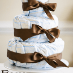 DIY stacked diaper cake with brown satin bows