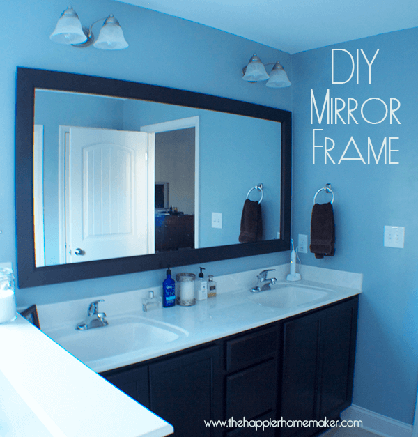 Diy bathroom mirror frame with molding the happier homemaker for How to frame mirror in bathroom