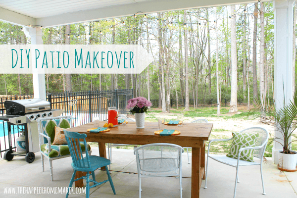 A DIY patio makeover with a wood table, white and blue chairs
