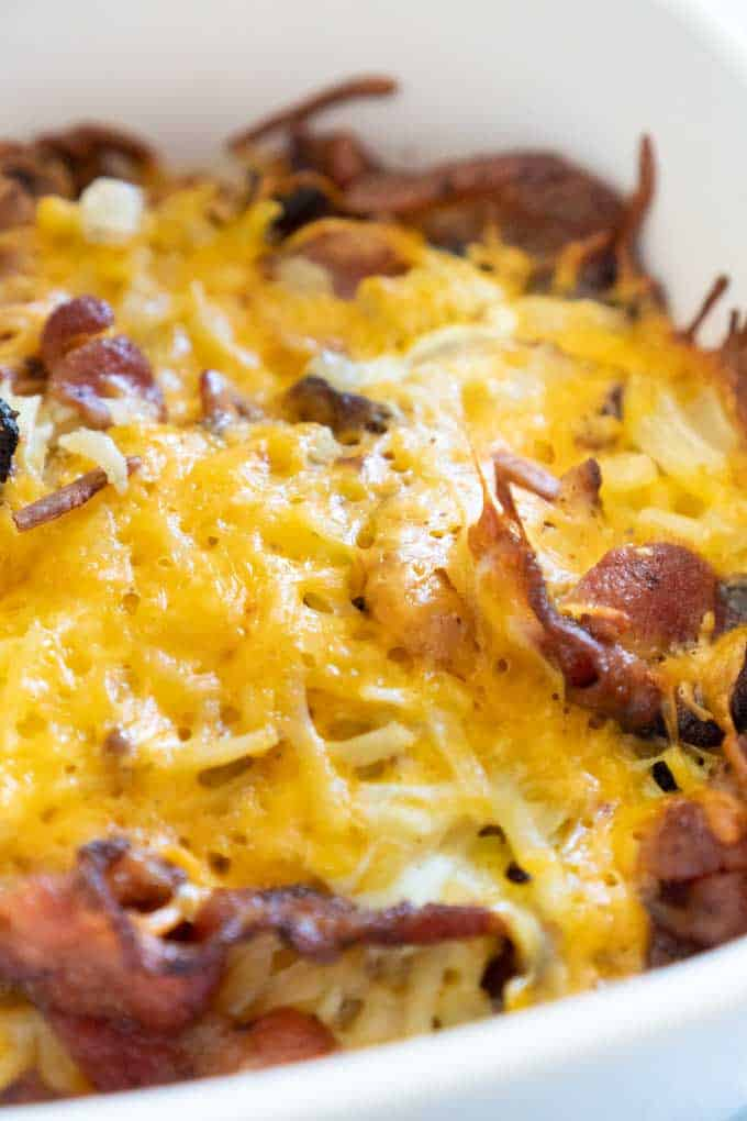 close up of cheesy bacon hash brown casserole