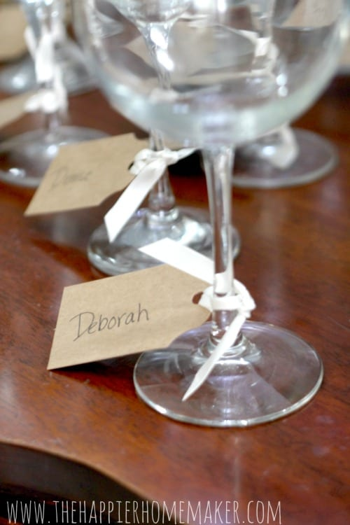 Wine tasting party cards tied to glass stems