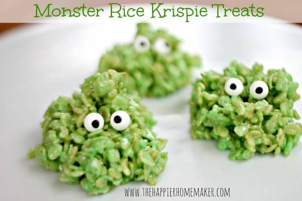 A close up of green Halloween monster Rice Krispie treats