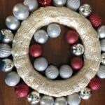 straw wreath form with ornaments on the inner and outer edge