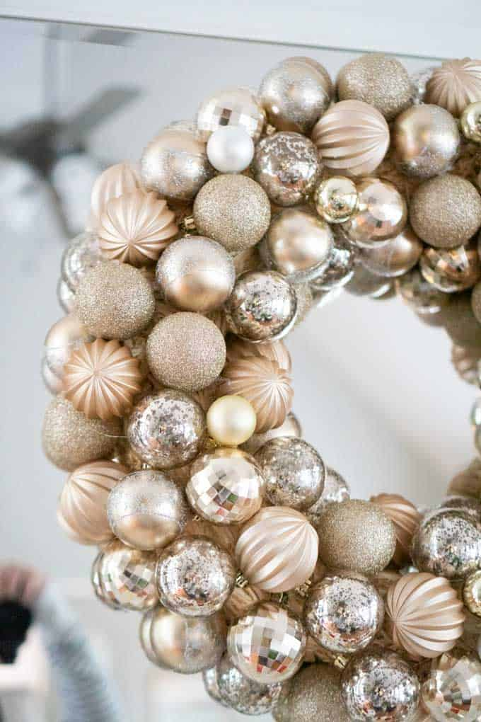 A close up of an ornament wreath on a mirror