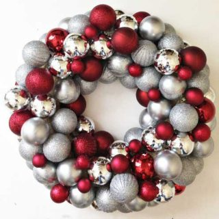 easy DIY ornament wreath can be made for as little as $20, much less expensive than store bought versions and easy to create custom colors!
