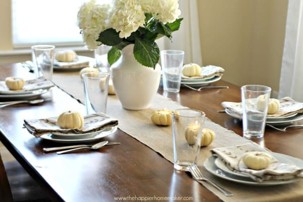 A Thanksgiving table setting with white hydrangea flowers