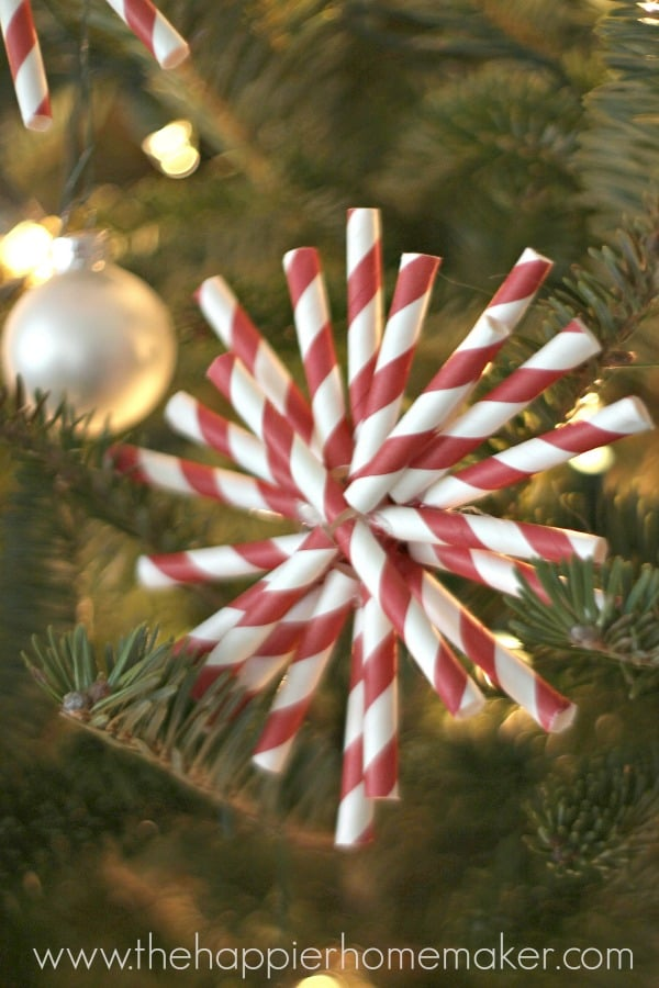 A close up of a DIY straw ornament