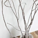 A close up of DIY iced branches for winter decor