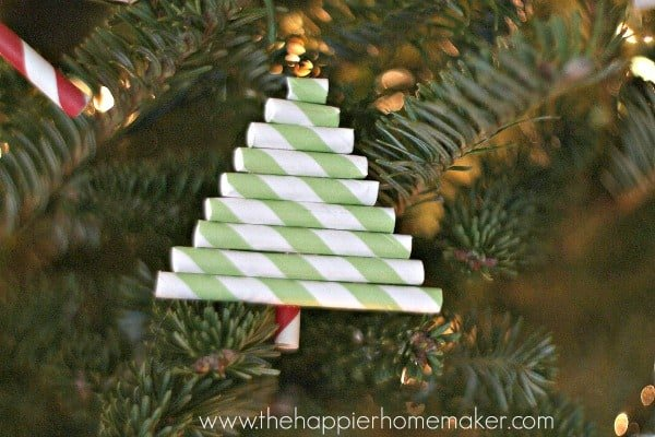 A close up of a DIY straw ornament shaped like a Christmas tree