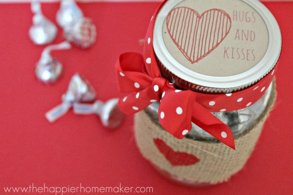 A close up of the top of a mason jar with Valentine\'s Day treats inside