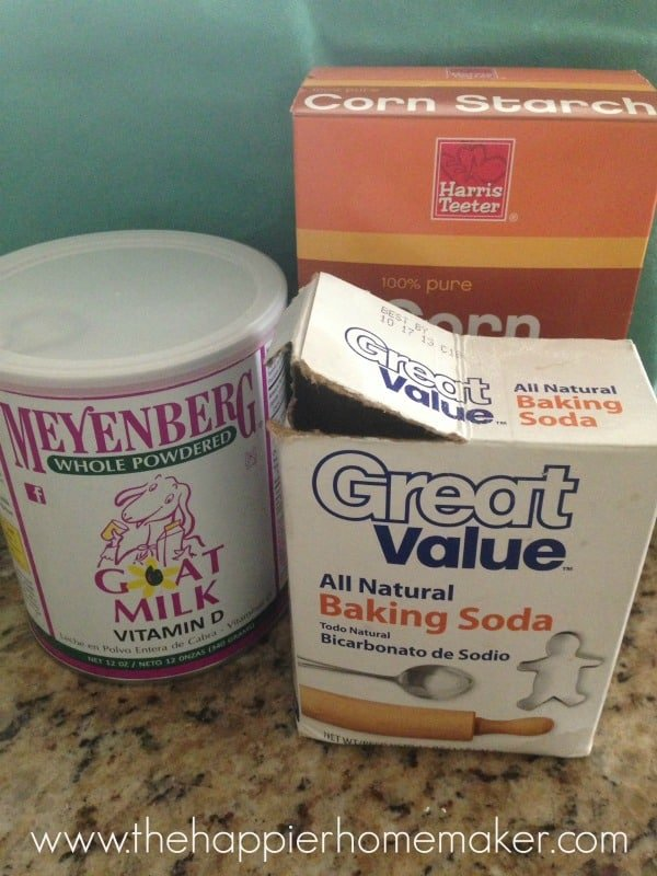 A collection of products to make homemade milk bath including baking soda and goat bilk