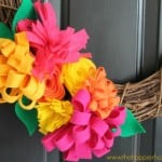 close up of grapevine wreath with felt flowers