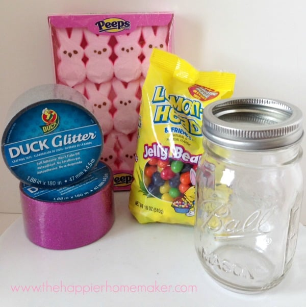 The supplies needed to make glittered peeps in a mason jar