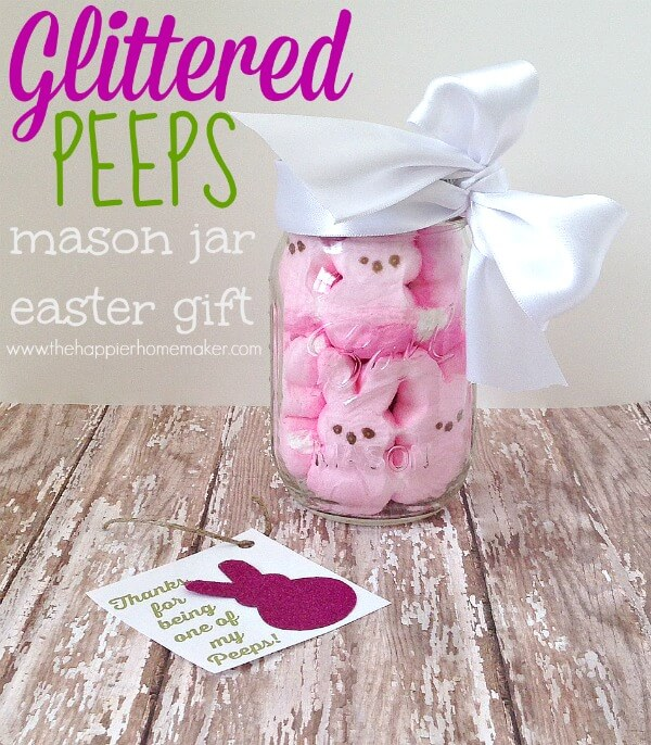 A close up of glittered peeps in a mason jar for Easter