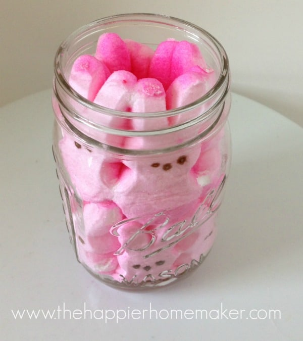 An in process picture of putting Peeps in a mason jar leaving room in the middle for jelly beans