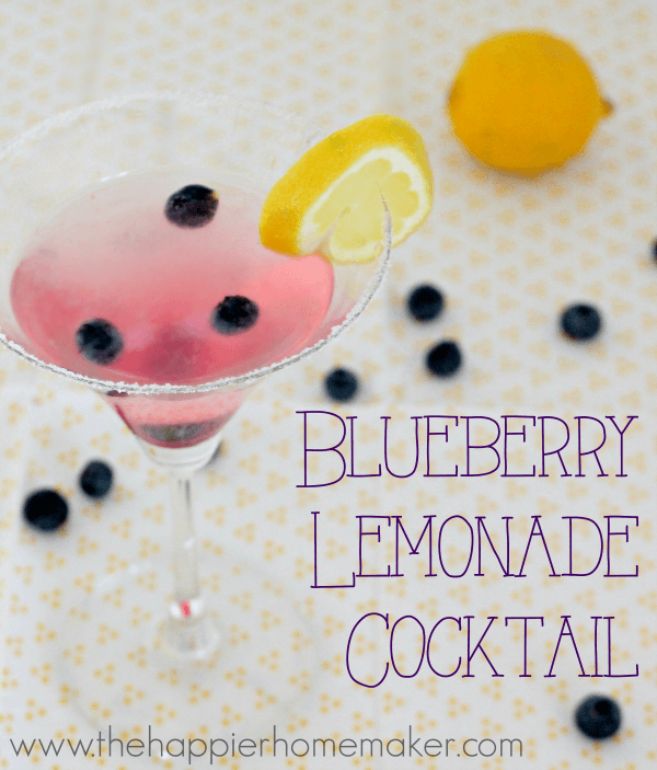 A close up of a blueberry lemonade cocktail garnished with blueberries and a lemon slice