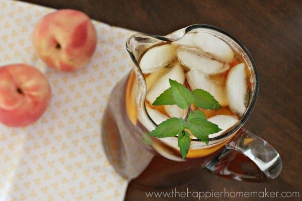 An overhead picture of a peach iced tea pitcher