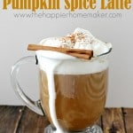 pumpkin psice latte with whipped cream and cinnamon stick in glass mug