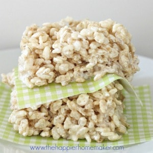 Two Rice Krispie Treats stacked on each other with wax paper between them