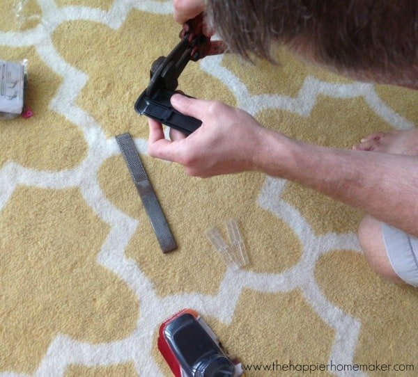using bolt cutters to trim command hook for hanging curtains