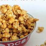 A close up of a bowl of microwave classic caramel popcorn