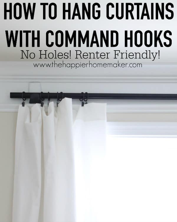 white floor length curtains hung with command hooks and curtain rod