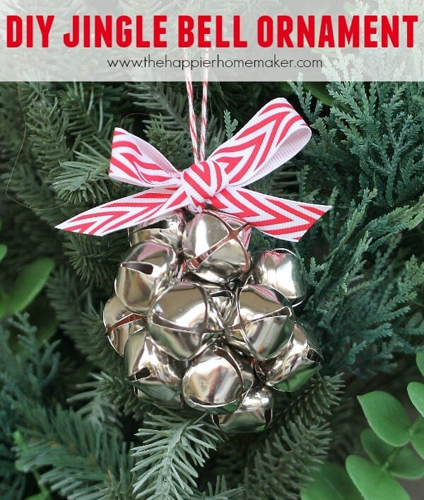 A DIY jingle bell ornament with a red and white bowtie