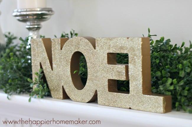 gold noel sign
