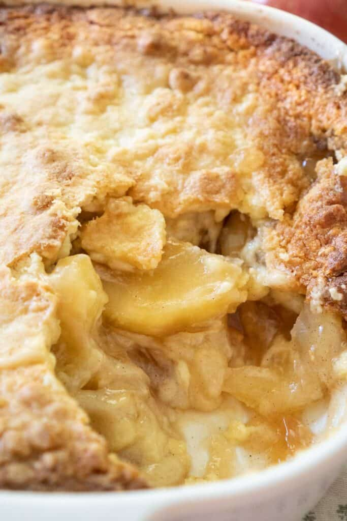 Apple dump cake with one scoop taken out