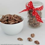 A bowl and jar of cinnamon sugared pecans