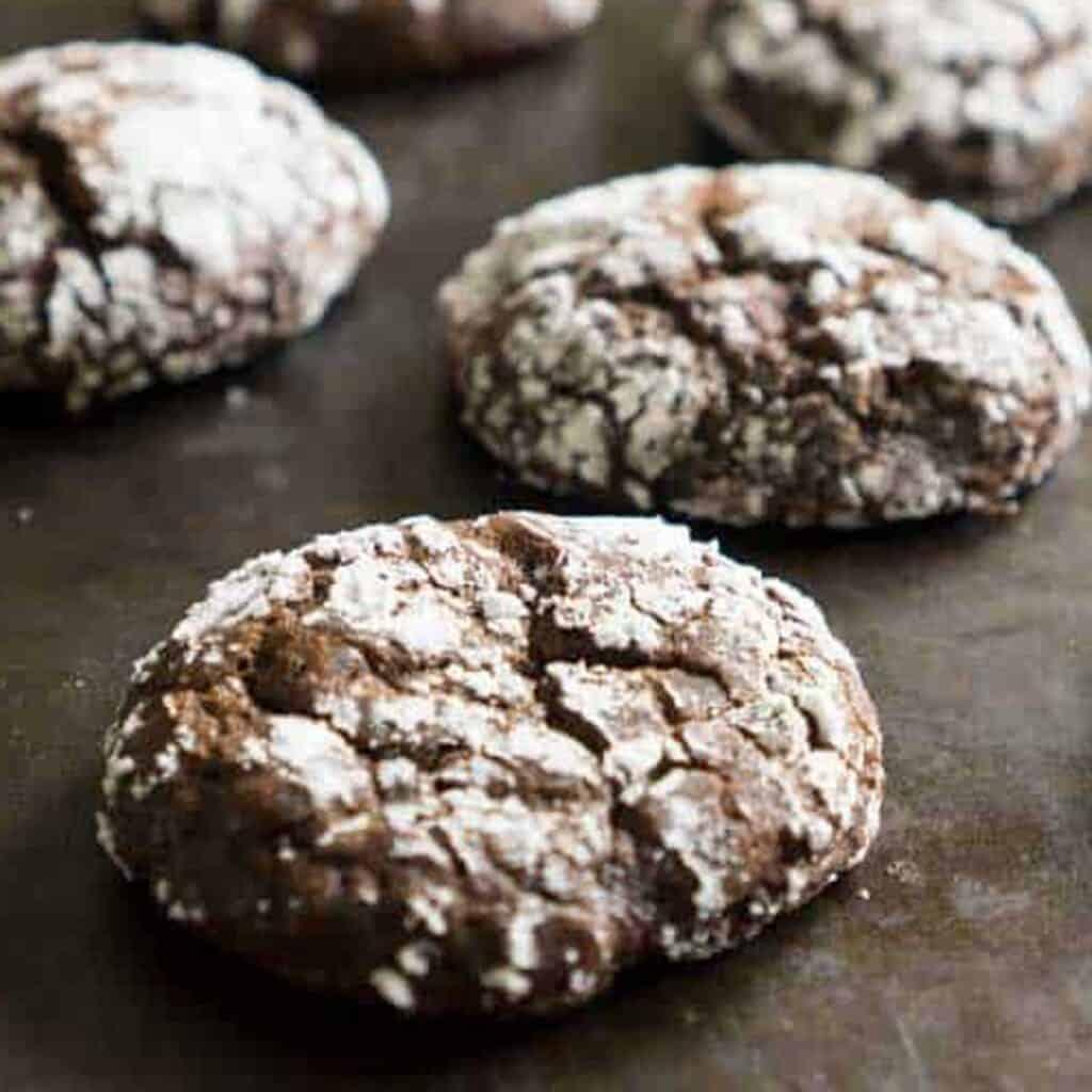 chocolate crinkle cookies on baking sheet