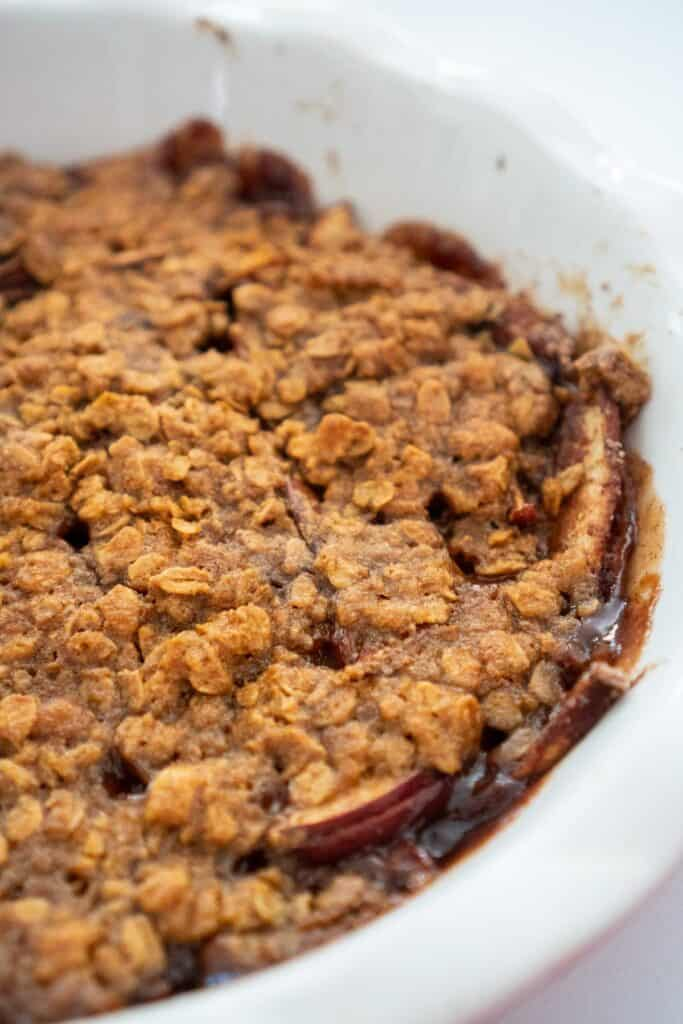 close up of peanut butter apple crisp in white pan
