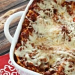lasagna in white casserole dish and red napkin