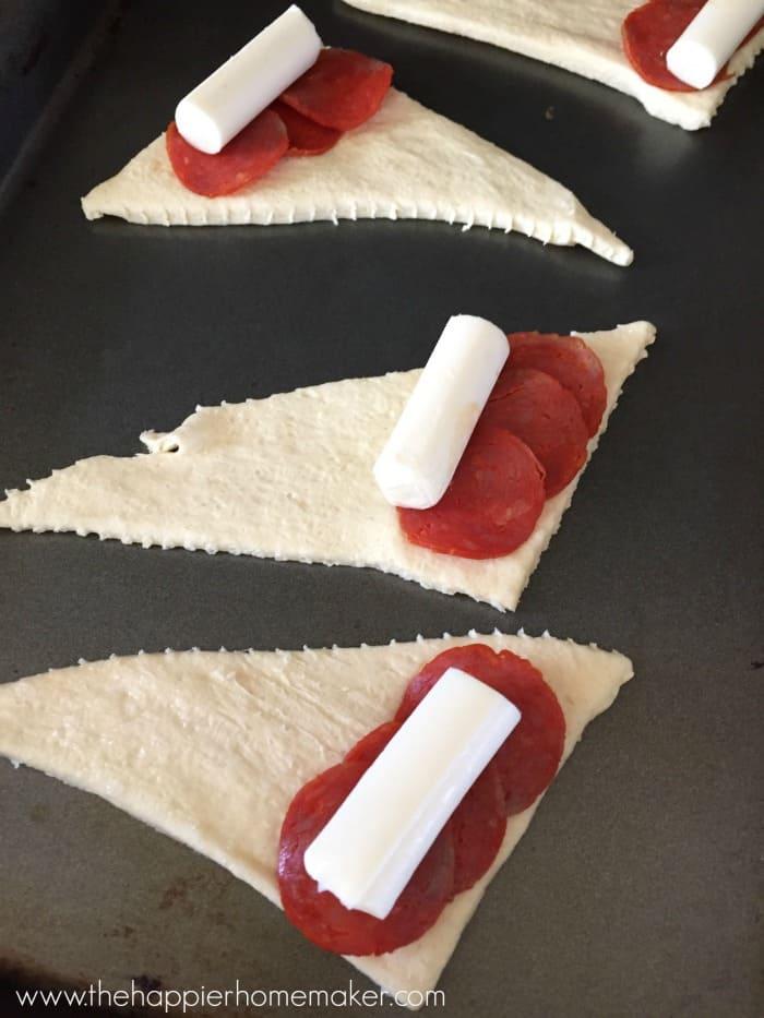 making pizza rolls