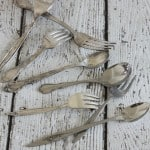 Assorted tarnished silver forks and spoons