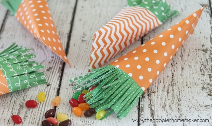 A close up of DIY Easter carrot goodie bags with candy inside