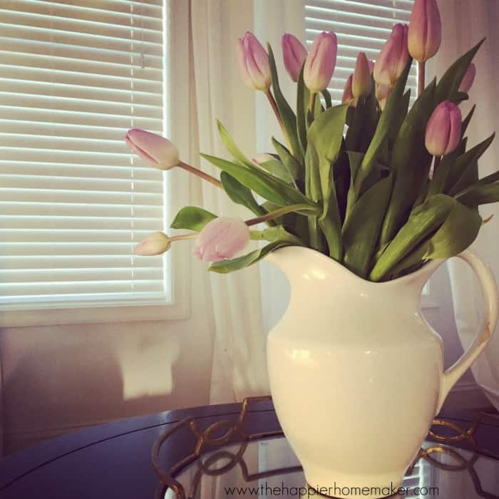 drooping tulips in wide vase