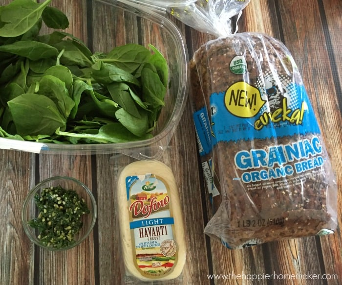 An overhead picture of the ingredients to make grilled cheese with spinach, pesto and havarti
