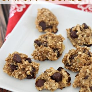 A close up of skinny banana oatmeal cookies on a white plate over a red and white napkin