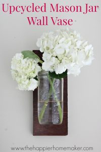 Turn a jar and a piece of scrap wood into a cute DIY gift- an upcycled mason jar wall vase!