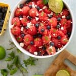 watermelon salad with blueberries mint feta in white bowl